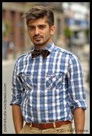 Corbata de moño y camisa celeste